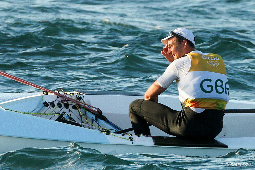 Giles Scott smiling after winning Olympi gold at the 2016 Rio Olympics.