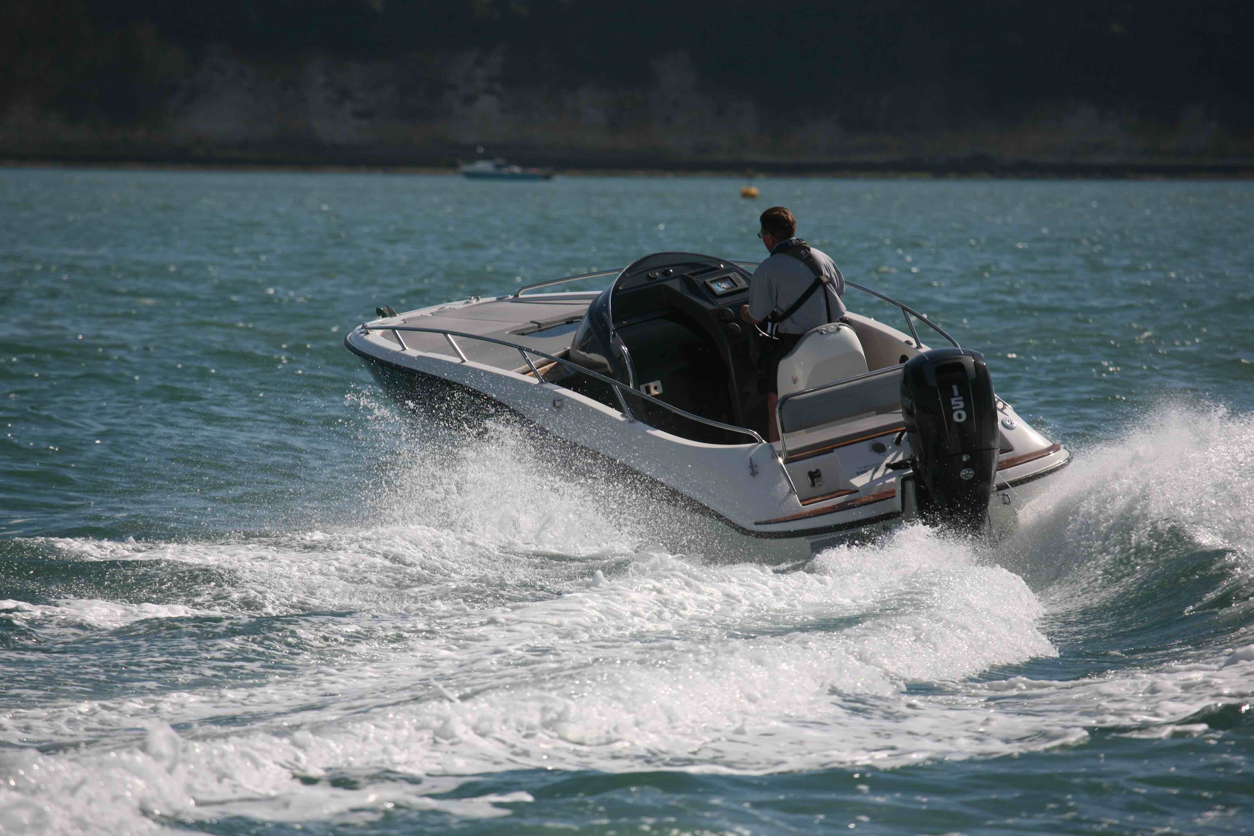 Outboard power and an offset helm console can bring big rewards on a small platform