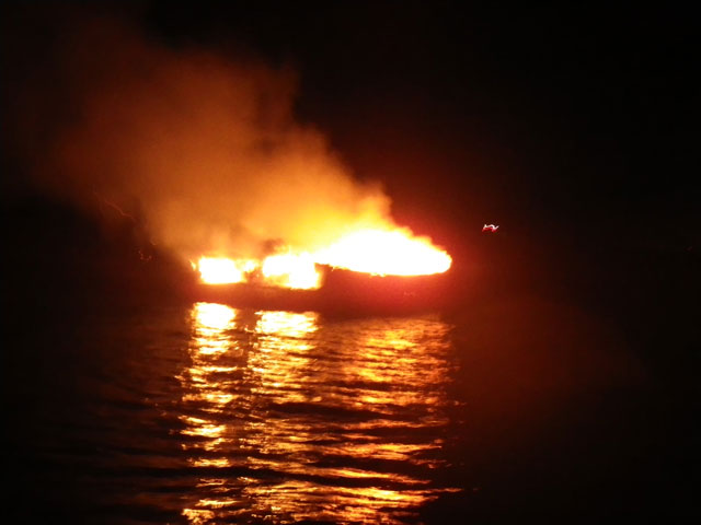Poole RNLI douses burning boat
