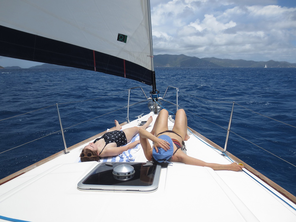 Sunbathing on a yacht charter in the British Virgin Islands