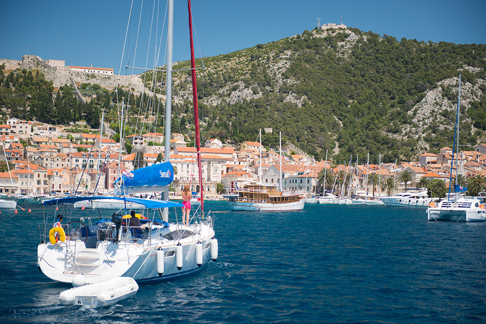 A Sunsail charter yacht heads into harbour in Croatia.