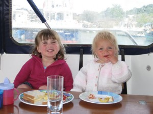 Children eating on a boat