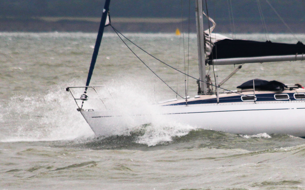 Motoring a yacht into rough seas