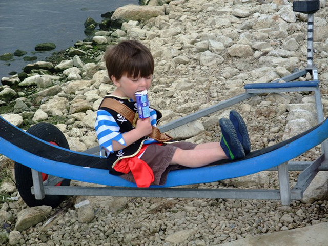 Kids dinghy sailing - sitting on a dinghy trolly