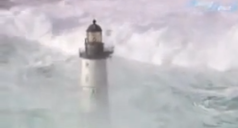 Waves crashing on lighthouses: aerial video