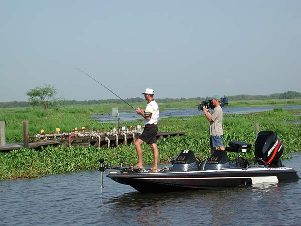 An ESPN cameraman shadows BASS Masters Classic leader Kevin VanDam of Michigan. Photo courtesy of B.A.S.S.