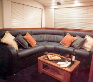 The luxurious sofa in the aft section of the salon can comfortably accommodate six people.