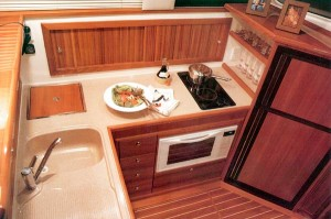 Even with a hot- and cold-water sink, a two-burner stove, a microwave oven and a refrigerator/freezer in the galley, there's ample counterspace for preparing meals.