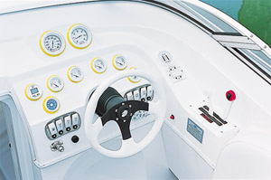 The helm station included a tilt steering wheel and white-faced gauges in yellow bezels.