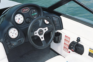 The helm featured an adjustable bucket seat, a vinyl-wrapped steering wheel, a Morse shifter/throttle, and Kysor Medallion gauges.