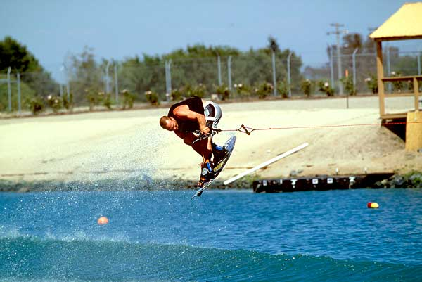 Once you're consistently clearing the wake, you can begin to learn tricks such as rail grabs and variations of them.