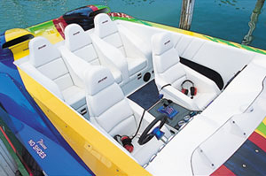 In addition to its twin high-back bucket seats, the 32' Skater's cockpit boasted a three-person bolster/bucket-style bench seat.
