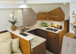 The galley — located a step down, just forward of amidships — is packed with all the amenities of home, including Corian countertops.
