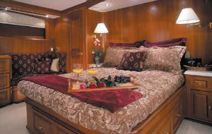 The master suite included a full-size bed and wooden cabinetry.
