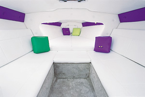or natural light over the V-berth and facing lounges in the carpeted cabin, the manufacturer included a deck hatch.