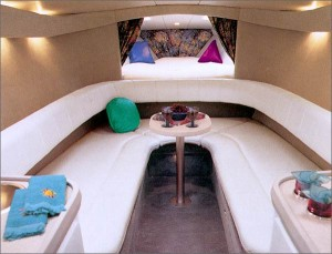 A horseshoe-shape lounge upholstered in UltraLeather HP and a two-person V-berth make the cabin inviting.