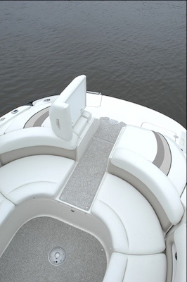 The sun pad flips up to allow for a center stern walk-through.