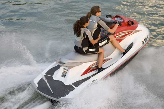 Longer, three-passenger seat and deeper, padded boarding platform are standard even on the entry-level VX Sport, shown here with optional mirrors.