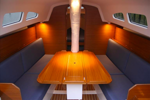 The interior is simple and linear. The saloon table can be removed and kept ashore for racing.