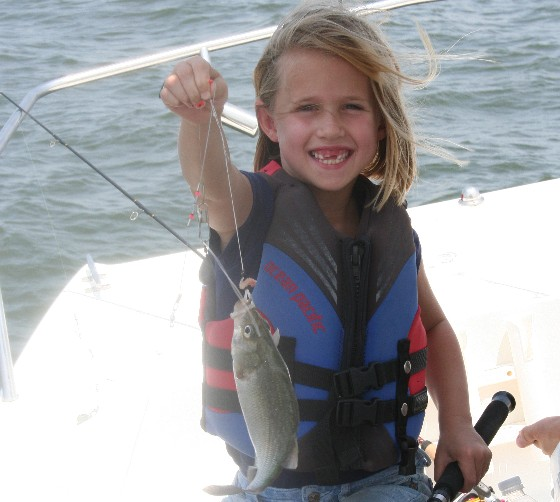 girl catching panfish