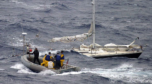 sinking sailboat rescued by US Navy
