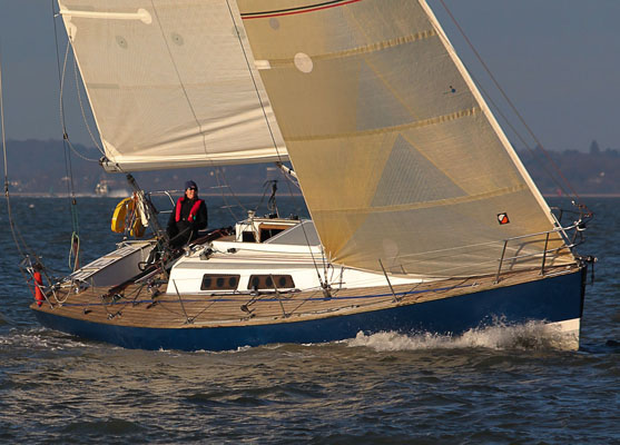 A photo of a sailboat with teak decks.