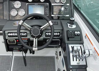 The helm station on the 330 CBR features chrome shifter/throttles, Livorsi Marine gauges, and a Garmin 547 color GPS/plotter.