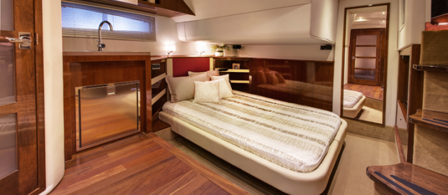 The mid-cabin master stateroom on the Four Winns H440 is open concept, meaning it flows right into the main salon, and vice versa.