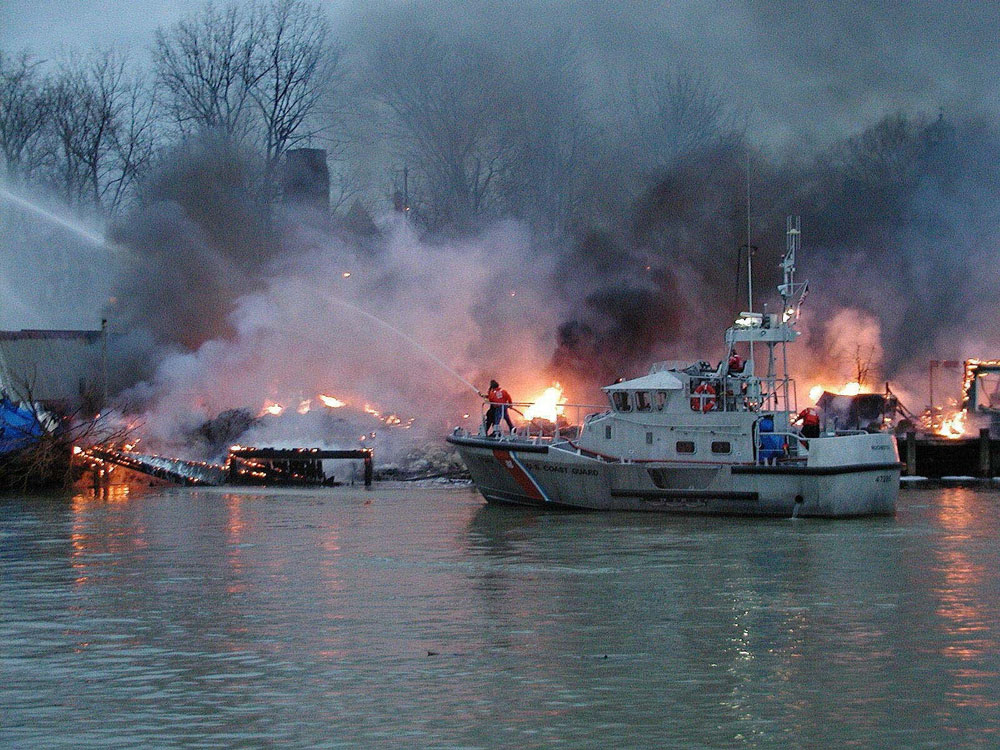 coast guard fighting boat  fire