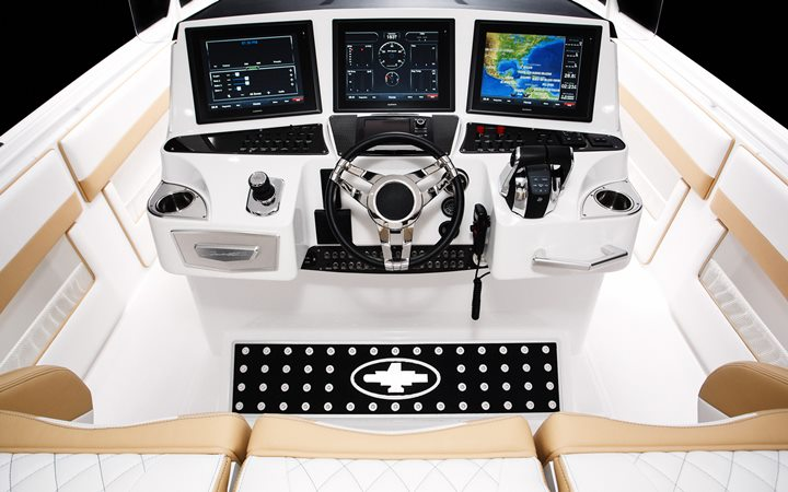 Goodies at the helm station include dual Garmin GPS units and Mercury Marine's advanced Axius and SkyHook systems.