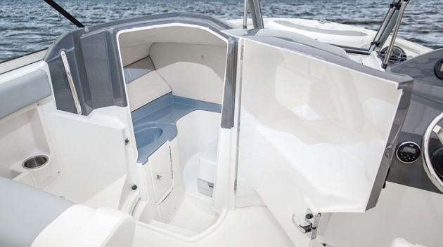 The port console has a head compartment with ports-potty and a wash basin hiding underneath it.