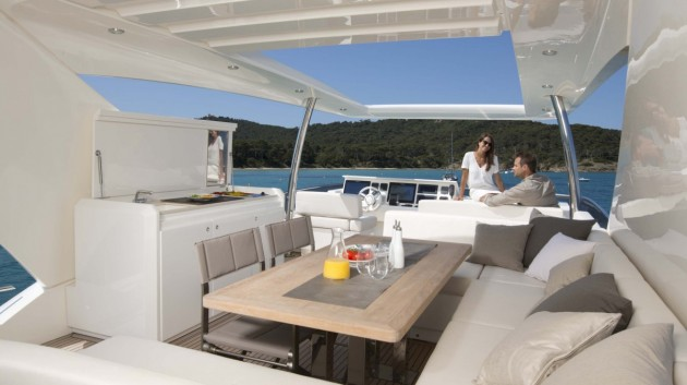 The flybridge on the Prestige 750 provides plenty of entertaining and relaxation areas for a a large group of guests.