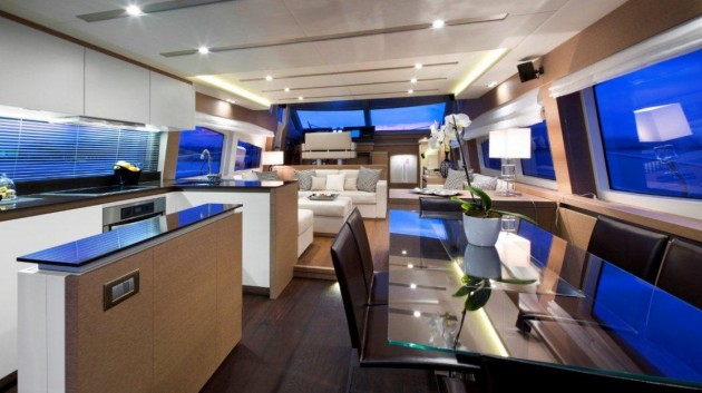 The galley aft arrangement facilitates serving both the aft cockpit, and the main salon, which has a dedicated dining area.
