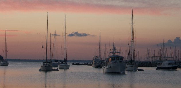 Boats sit quietly at both morning balls, and on their own anchors in Annapolis Harbor, MD.