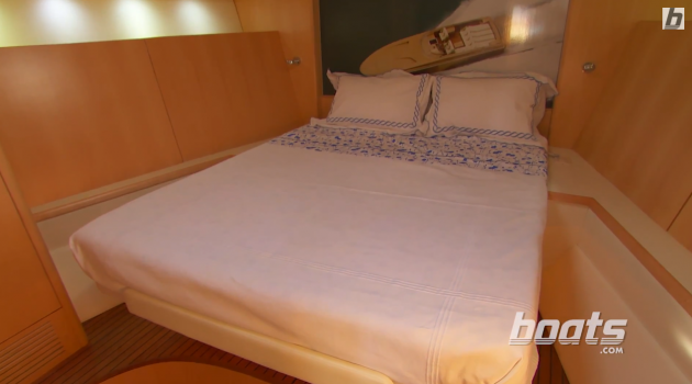The master stateroom on the Magnum 51 Bestia has a large, centerline berth tucked up into the bow.