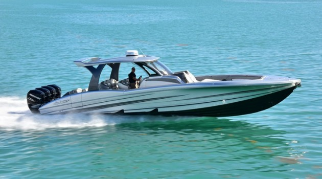 Like most MTV V 42 center consoles, this silver beauty is powered by quad 300-hp Mercury Verado outboard engines.