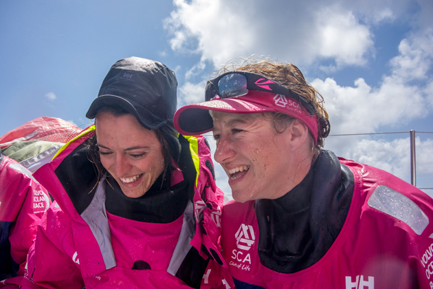 Annie's trademark grin is contagious, as teammate Justine  Mettraux learned as they crossed the equator for  the first time. Photo: Team SCA/Sophie Ciszek