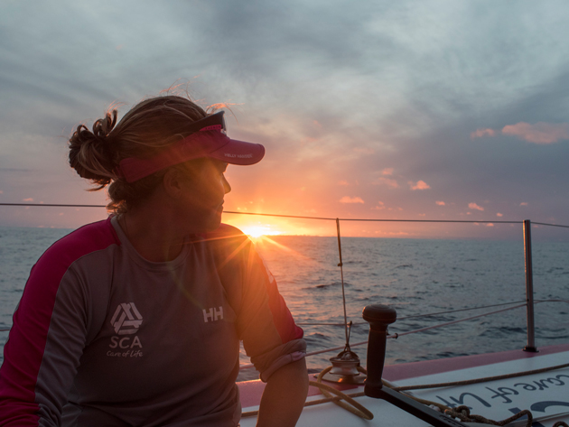 Watching sunset offshore sparks a rare moment of relaxation for Sally. Photo: Corinna Halloran/Team SCA/Volvo Ocean Race