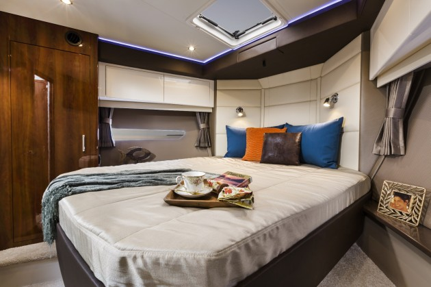 The island berth in the extremely roomy master stateroom. Photo courtesy of Carver