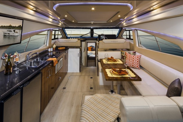 Carver has always had a knack for making the most out of every inch of space on its boats, and that skill is apparent in the roomy main salon. Note the overhead opening sunroof, covered by a sunshade in the photo. Photo courtesy of Carver