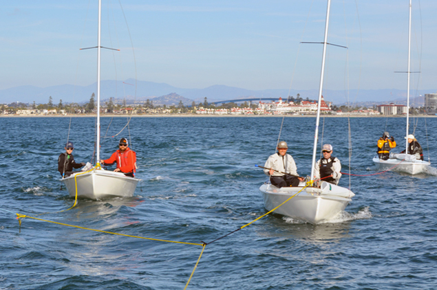 Small racing dinghies like these Snipes often tow to and from the race course.