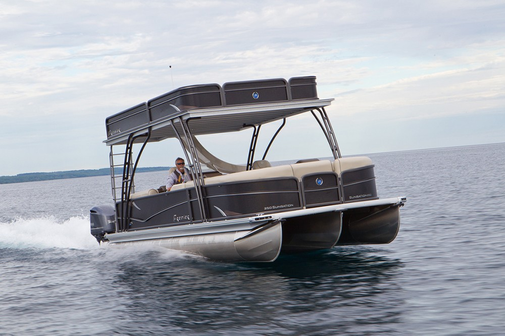 "The Premier Sunsation 270 Walk-On blasts across Little Traverse Bay with two Yamaha F300s strapped to its stern. Can you say, ""Yeehaw?"""