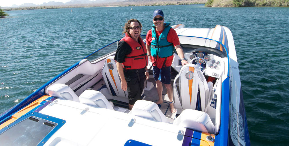 Brad Schoenwald (left) , a highly experienced instructor at Tres Maartin's Performance Bot School, takes to the water with a student in a catamaran.