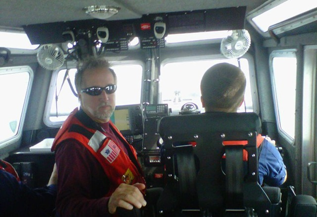 Tres Martin provides instruction on a U.S. Coast Guard rescue boat.