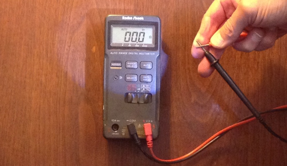 Fig. 5 - To check your multimeter's internal battery, set it to the ohms reading and touch the two probes together. You should get a zero reading, indicating no resistance and a good battery.