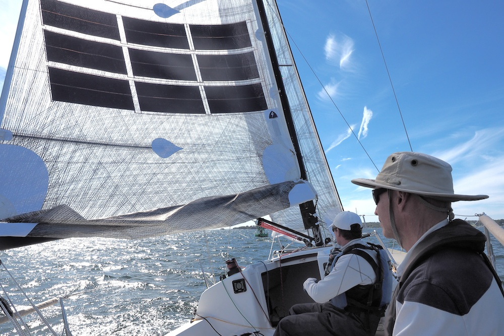 J/88-Oceanvolt-reaching-under-reefed-mainsail.