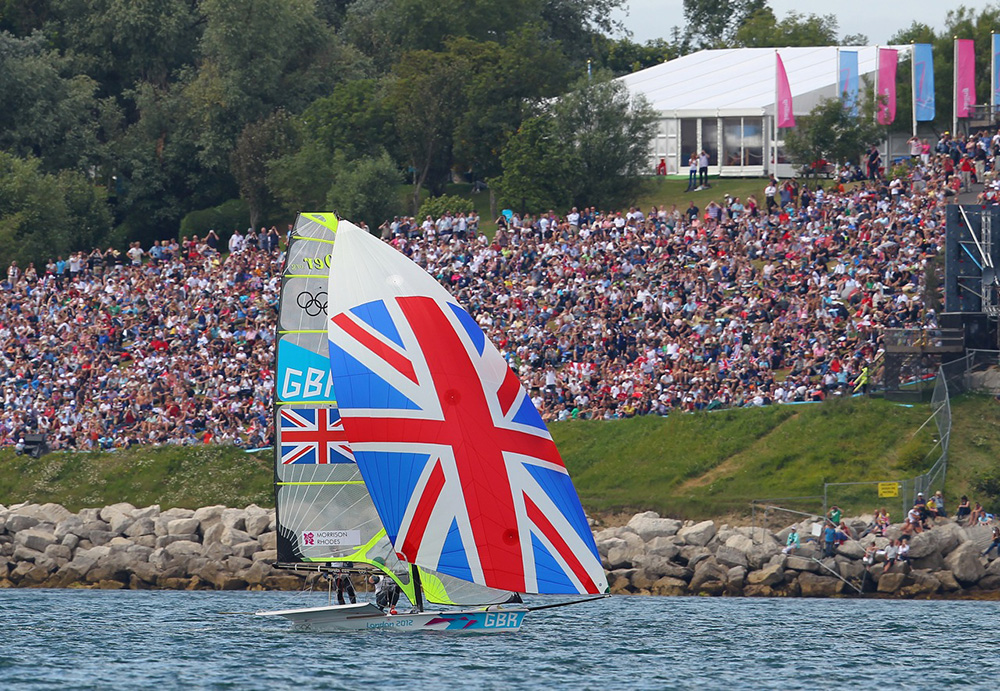 This photo captures the medal race sailing at the 2012 Olympic Games, as a 49er races close to the crowds. Photo OnEdition.