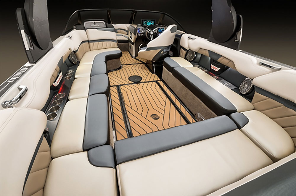 Inside, the Malibu is as tricked-out as they come. Note the multiple touch-screen displays gracing the helm station.