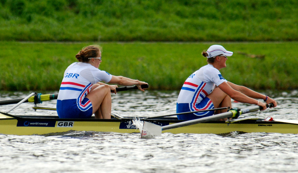 Great Britain's Women's Pair (-) in the 2014 World Rowing Championships.  Rowing sweeps in a pair requires great balance and harmony between the rowers.