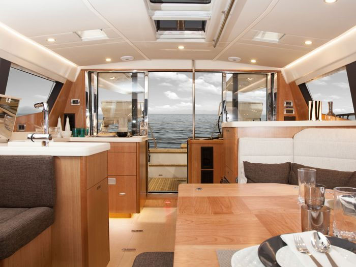 To starboard and aft in the Moody's cabin is a galley with large Corian counters, twin sinks, a stove/oven combination, and a small dishwasher.